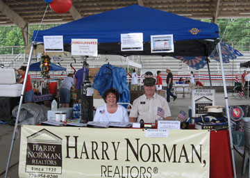 (On the left) Faye Meyer - Harry Norman, Realtors® on the Square in McDonough office Executive Assistant and Comptroller, and Mark Barr - Harry Norman, Realtors® Sales Associate who served in the Marine Corps.
