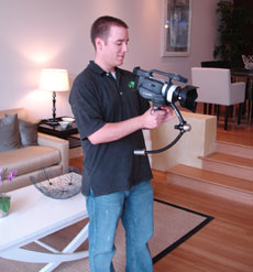 Videographer Tim Kent works with state-of-the-art equipment to make videos for Hill & Co. luxury properties.