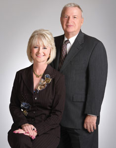 Thea McShay (left) and Al Hanks (right), two top-producing John Daugherty agents with 50 years of combined real-estate experience.
