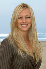 Kelly Dinnsen, a REALTOR with Willis Allen who raised $10,500 for a San Diego surf camp.