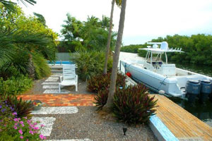 The dock at Jimmy Buffett's Key West home is suitable for most boats.